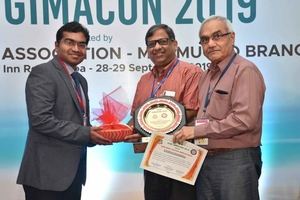 Dr. Rahul Kulkarni being felicitated at GIMACON 2019 - OncoWin Clinic | Aundh, Pune